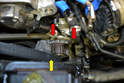 Remove the belt from the water pump sprocket (yellow arrow).