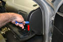 Use a trim removal tool, open the glove box and gently pry (red arrow) the dash end plate away from the dash.