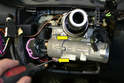 You will need to scrap the factory sealing paint off of the ignition assembly if you have the original switch, then use a small flathead screwdriver and loosen the two screws holding the switch in place (yellow arrows).