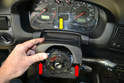 Lift the trim piece up (red arrow) and pull the end of the piece away from the instrument cluster (yellow arrow).