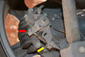 Adjustment - ThisPicture illustrates where the end of the cable sits in the retaining clip on the caliper (yellow arrow) and the ball end sits in the tensioning arm (red arrow).