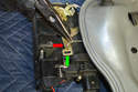 Remove the inner pull cable (red arrow) from the lock bracket (green arrow).