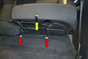 Use the pull strap (yellow arrow) to pull the seat cushion forward and up.