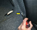 Use a flathead screwdriver and push the retaining hook (yellow arrow) towards the rear of the car while lifting up on the seat.