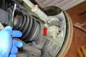 Next, use a 5mm Allen and remove the bolt holding the sensor in place (red arrow).