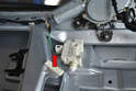 Remove the wiring connector (red arrow) from the actuator.