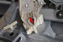 Volkswagen calls for the use of special tool T10010 to remove the actuator, but if you are careful you can use a set of Vice Grips and loosen the two studs on the actuator (red arrow).