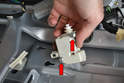 Slide the actuator from its two mounting screws.