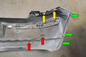 On the back of the left side bumper cover you can see the license plate light connection and grommet (red arrow), the clips for the T25 Torx screws in the wheel well (green arrows) and the upper body mounting clips (yellow arrows).