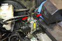 Clean the top of the ABS unit and remove the two supply lines (red arrows) from the master.