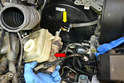 Pull the master cylinder (red arrow) from the brake booster (yellow arrow) and take it to your bench.