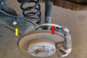 The line on the rear caliper is a combination hard line (yellow arrow) and rubber line (red arrow).