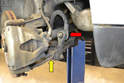 This photo illustrates the drop link that attaches the sway bar (red arrow) to the control arm (yellow arrow).