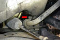 The sway bar bushing and bracket is held in place by a 13mm bolts (red arrow).