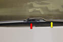 The front wiper blades are attached to the wiper arms (yellow arrow) by a flexible joint (red arrow) on the blade itself.