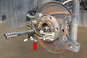 Use a three arm puller (red arrow) and pull the old hub/bearing off.