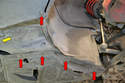 To remove the lower wheel liner; begin by removing the six lower T25 Torx screws (red arrows shown, yellow arrow not shown) holding the lower liner on.
