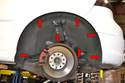To remove the rear liner, remove the seven T25 screws (red arrows) in the inside of the wheel arch and the one below (yellow arrow).