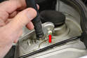 Hood shock - Pull the shock straight off the mounting ball (red arrow).