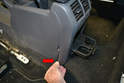 Use a trim removal tool or your fingers and gently separate the plastic surround from the base (red arrow) on both sides.