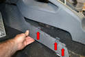 Use a trim removal tool and slip it between the lower trim piece and the console.