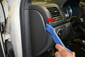 A Pillar Upper: Begin by using your trim removal tool and gently prying the dash end cap away from the dash (red arrow).