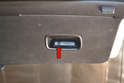 Remove the single Philips head screw from each handle (red arrow).