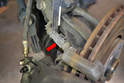 Disconnect the wear sensor from the harness (red arrow).