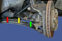This photo illustrates the three parts of the tie rod; the outer tie rod end (green arrow), inner tie rod end (yellow arrow), and the tie rod boot (red arrow).