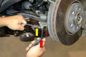 The inside of the tie rod bolt is slotted for a 6mm Allen wrench (red arrow), you will most likely need to use the Allen wrench to hold the tie rod while unscrewing the'mm nylex nut (yellow arrow).