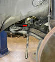 The ball joint end of the inner tie rod (red arrow) attaches to the steering rack.