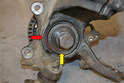 ': Make sure to support the inner race of the bearing (yellow arrow) and do not use the hub flange (red arrow) as a support point for the press.