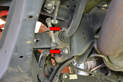 Next use a 10mm 12 point and loosen and remove the two bolts holding the sway bar bracket to the frame (red arrows).