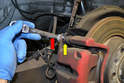 To remove the caliper use a 15mm wrench to counter hold the guide pins (yellow arrow) while removing the 13mm bolts (red arrow).