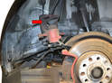 Hang the caliper up out of the way (red arrow) with a bungee cord or piece of rope.
