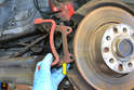 Remove the caliper mounting bracket (yellow arrow) from the bearing carrier.