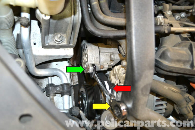 volkswagen golf gti mk v alternator replacement 2006 2009 remove the ribbed drive belt and lock the tensioner in the locked position