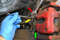 The rubber flexible line attaches to the hard line at the bracket on the caliper.