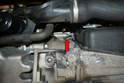 Working from under the car you will need to use a 16mm wrench and remove the lower mounting bolt (red arrow).