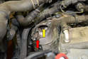 With the starter removed, check the mounting area (red arrow) for any dirt, corrosion or debris.