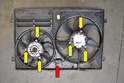 There are three 10mm nuts (yellow arrows) holding each fan to the shroud.