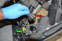 Disconnect the wiring harness from the headlight unit (red arrow).