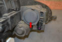 Pull the rubber cap (red arrow) off the housing to give access to the high beams.