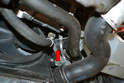 You can disconnect the quick release connection (red arrow) on the lower right radiator hose and separate the hose from the radiator.
