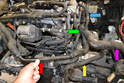 With the front of the vehicle removed you can see all the hoses that come off the upper radiator hose (purple arrow).