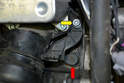 This photo illustrates the mounting clip with the 6mm Allen bolt (yellow arrow), you can also see the engine speed sensor (red arrow).