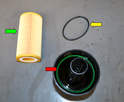 Remove the old O-ring (red arrow, this one happens to be green), insert the new O-ring (yellow arrow) and slide the new filter (red arrow) into the filter.