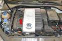 You can open the oil fill cap (red arrow) on the top of the engine to break the vacuum and assist in draining the oil.