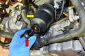 The oil filter and housing (yellow arrow) are located on the front of the motor.