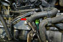Use a set of pliers or channel locks and remove the coolant pipe from the front of the oil cooler.